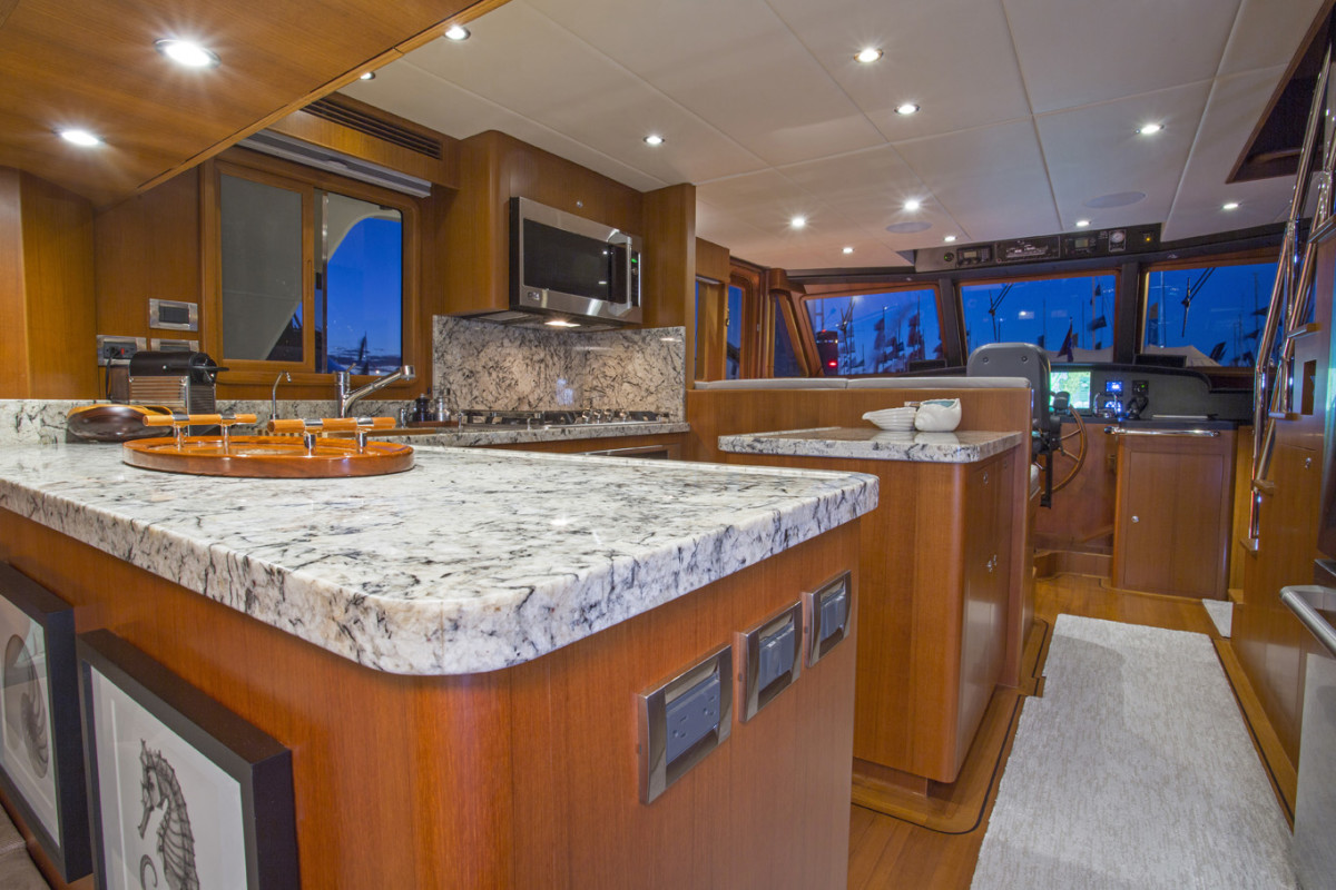Rare in a yacht this size, the U-shape galley with full-size appliances is large enough for plenty of cook and prep space.
